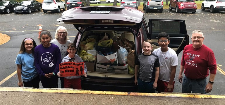 members of the Rotary collect donations from Edgewood Elementary for the Bucks County Emergency Homeless Shelter.