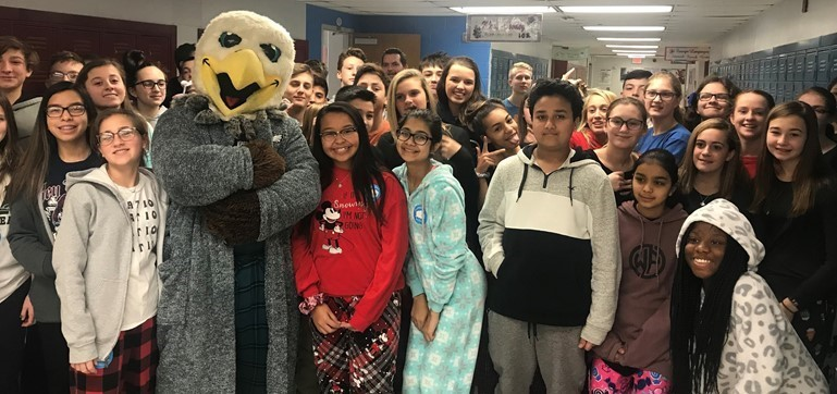 The Eagles Swoop mascot donned his robe to pay a visit to William Penn Middle School to support PJ Day for CHOP!