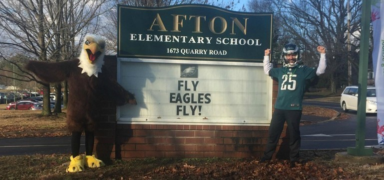 The Afton Eagle and Principal Dr. Masgai greeted students as they arrived for school on the morning after the Super Bowl.