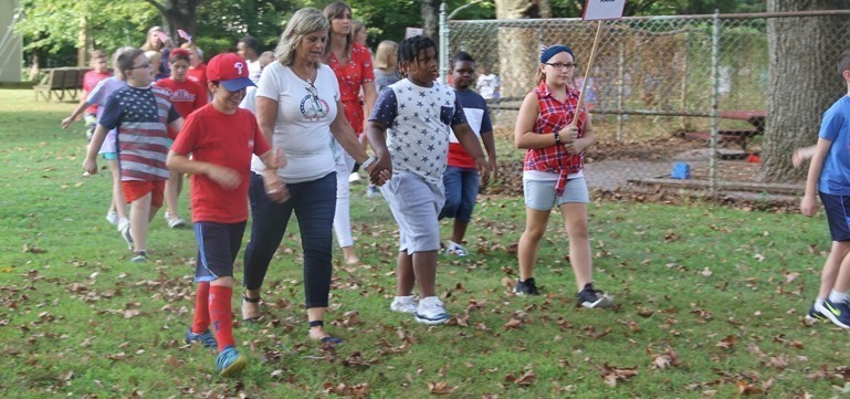 Makefield Elementary Principal Donna McCormick-Miller led the school's annual Walk to Remember on Patriot Day.