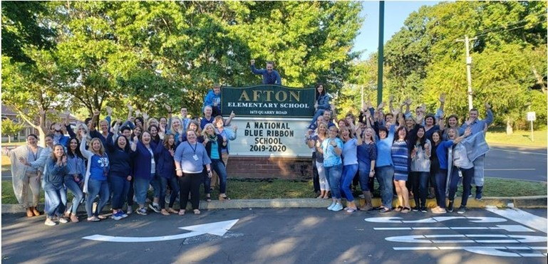 Afton Principal and Teachers cheer becoming a National Blue Ribbon School