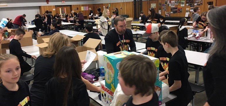 More than 160 Pennsbury elementary students gathered for the 4th annual Day of Service in memory of Dr. Martin Luther King, Jr.  Blankets, cards, activity and supply kits were among the items assembled as donations for community groups.